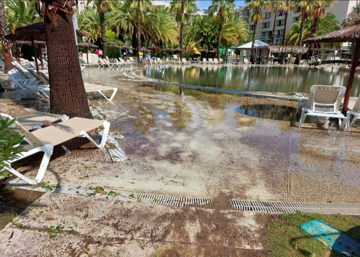 Hotel damage with swimming pool muddy water.